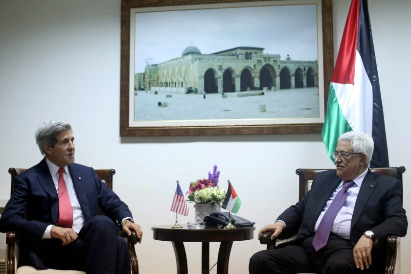 Secretary of State John F. Kerry, left, meets with Palestinian Authority President Mahmoud Abbas in the West Bank city of Ramallah.