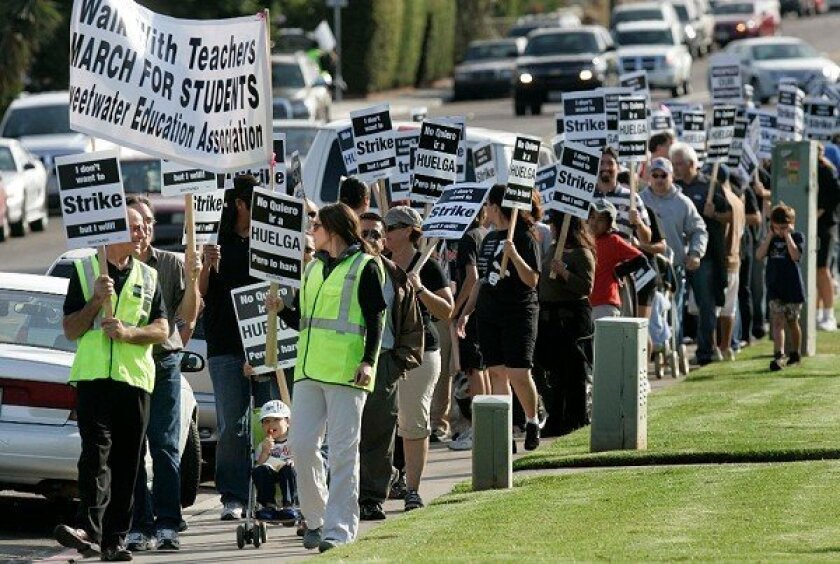 Hundreds of teachers from the Sweetwater Union High School District march Wednesday over stalled contract talks.