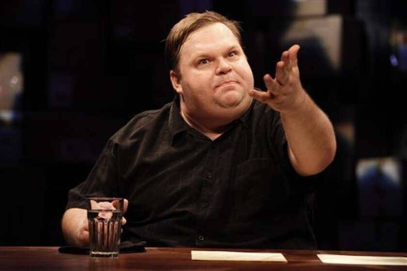 """In this theater publicity image released by Public Theater Press Office, Mike Daisey stars in """"The Last Cargo Cult,"""" running off-Broadway at the Public Theater in New York. (AP Photo/Public Theater Press Office, Joan Marcus)"""