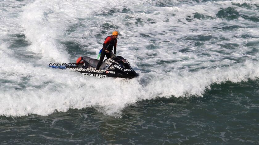 A lifeguard on a jet ski patrols the water off of Beacon's Beach Sunday. photo by Bill Wechter