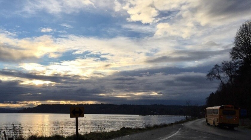 A school bus runs its route shortly after dawn on Vashon Island, where nearly 78% of the vote in November went to Hillary Clinton.