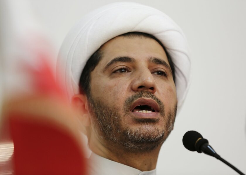 Sheik Ali Salman, leader of the main Shiite opposition group Al-Wefaq, explains why his and other opposition groups are refusing to participate in upcoming elections at a press conference in Manama, Bahrain, Saturday, Oct. 11, 2014. Opposition leaders announced Saturday that the Al-Wefaq society and four smaller groups will boycott the Nov. 22 parliamentary and municipal elections in the Gulf island kingdom. (AP Photo/Hasan Jamali)