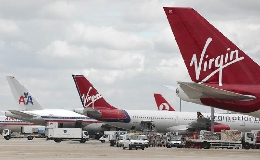 Virgin Atlantic aircraft stand at Heathrow Airport in London.