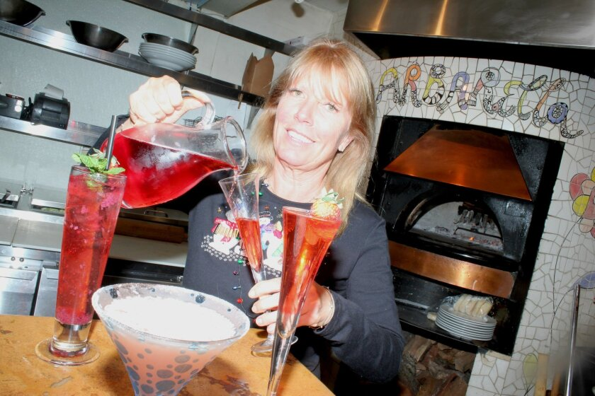 Barbarella owner Barbara Beltaire, seen here pouring a Ginger Bells, won't put a drink on the menu before approving it first, according to bar manager Torria Larson. At 22 drinks added to the holiday menu, Beltaire spared no amount of variety.