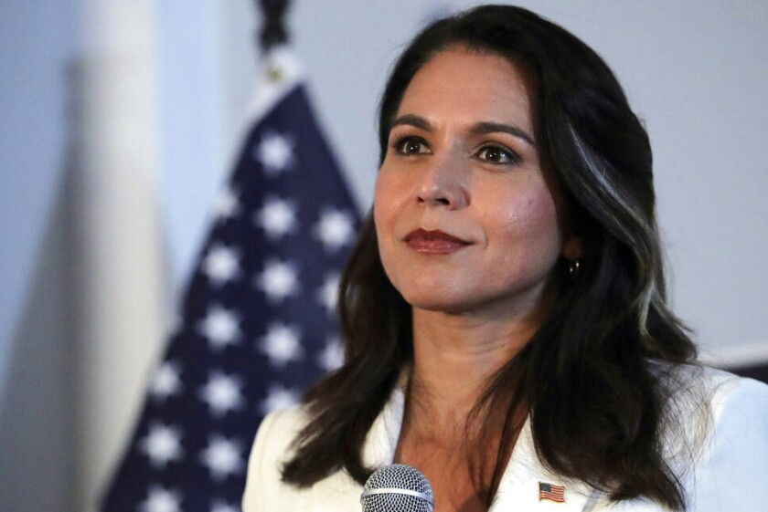 Rep. Tulsi Gabbard of Hawaii, pictured Oct. 1 during a campaign stop in New Hampshire, has gotten renewed attention lately after a heated argument with former Democratic presidential nominee Hillary Clinton.