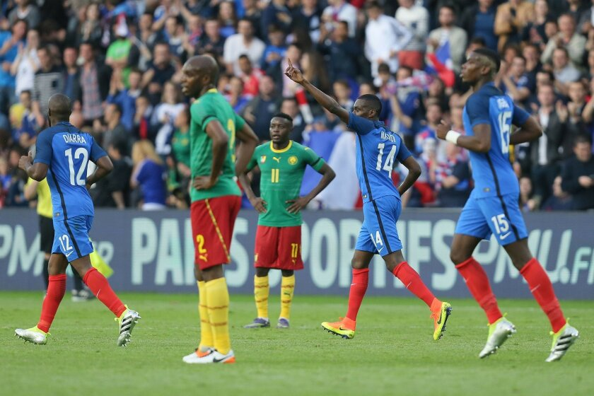 France's Blaise Matuidi, second right, celebrates with teammates after scoring the first goal during a friendly soccer match between France and Cameroon at the La Beaujoire Stadium in Nantes, western France, Monday, May 30, 2016. The French squad is in preparation for the EURO 2016 soccer champions