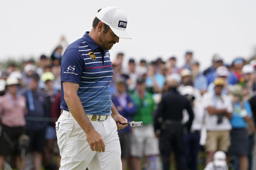 Louis Oosthuizen, of South Africa, looks down after missing a putt on the 16th green during the final round of the U.S. Open Golf Championship, Sunday, June 20, 2021, at Torrey Pines Golf Course in San Diego. (AP Photo/Jae C. Hong)