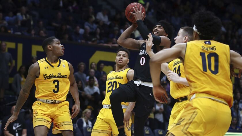 San Diego's Devin Watson (0) shoots against California's Paris Austin (3), Matt Bradley (20), Grant Anticevich (34) and Justice Sueing (10) in the first half.