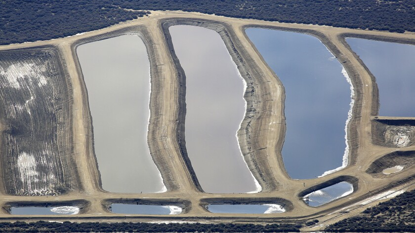 Pits containing production water from oil wells in Kern County.