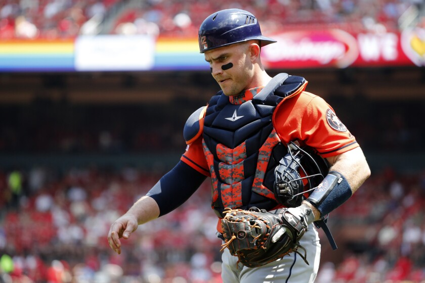 Houston Astros catcher Max Stassi walks off the field during a game against the St. Louis Cardinals on Sunday.