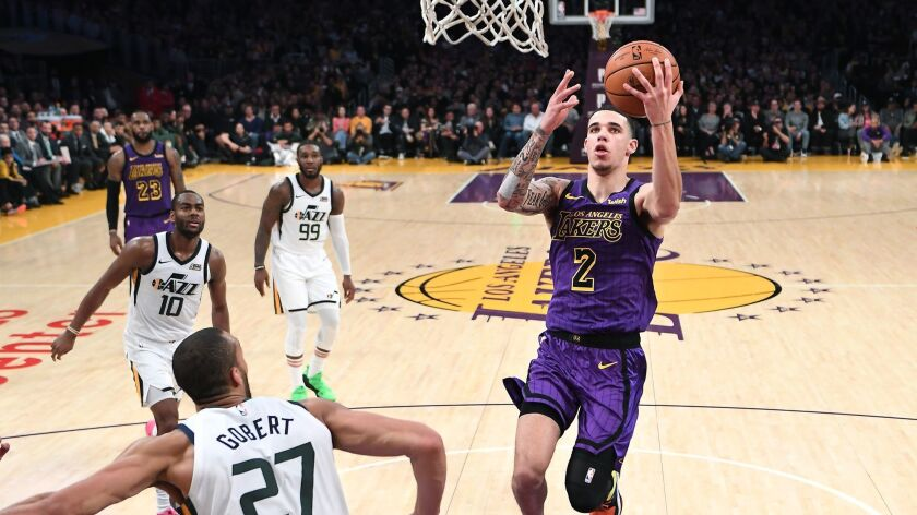 Lakers' Lonzo Ball scores drives to the basket for a layup against the Jazz.