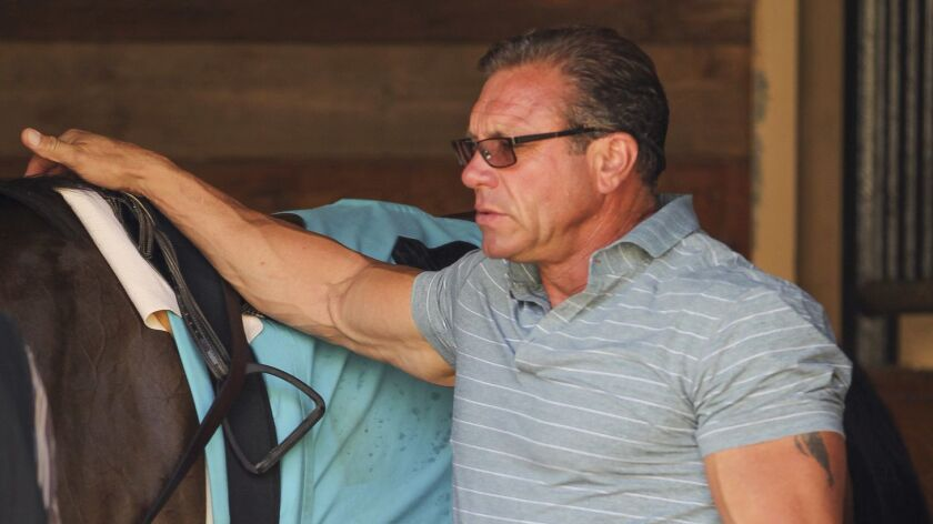 July 23, 2015, Del Mar, CA | Horse trainer Jeff Mullins prepares his horse In Dad's Honor for the se