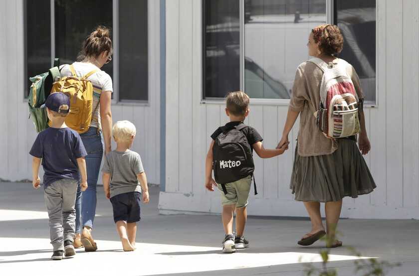 Parents pick up their children from the new Sycamore Creek Community Charter School in Huntington Beach on its second day of school Thursday.
