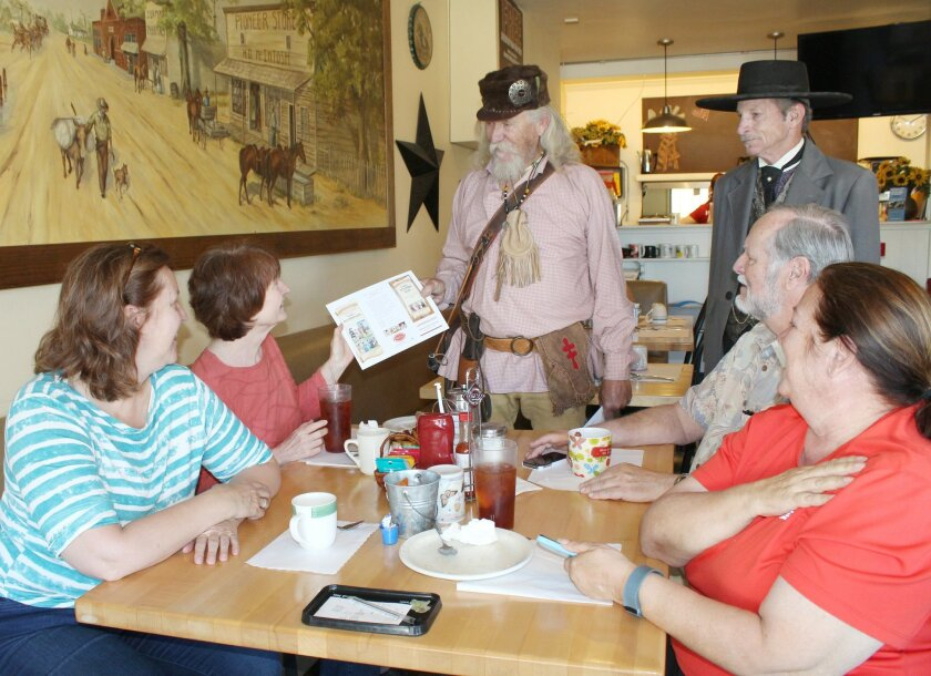 Jim Cooper and Steve Johnson, dressed in their Old West Days outfits, share information about this weekend's event with Marty Downey of Poway, Bonnie Wheeler of San Diego, David Roger of Ramona and Susan Fonss of Ranch Santa Fe.