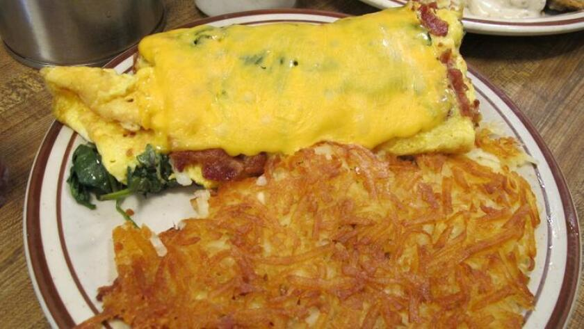 Hash browns with your eggy breakfast are a staple at Harry's. (Amy T. Granite)