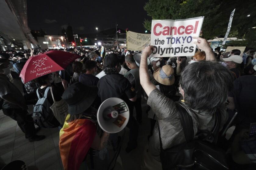 Anti-Olympic protestors demonstrate near the National Stadium