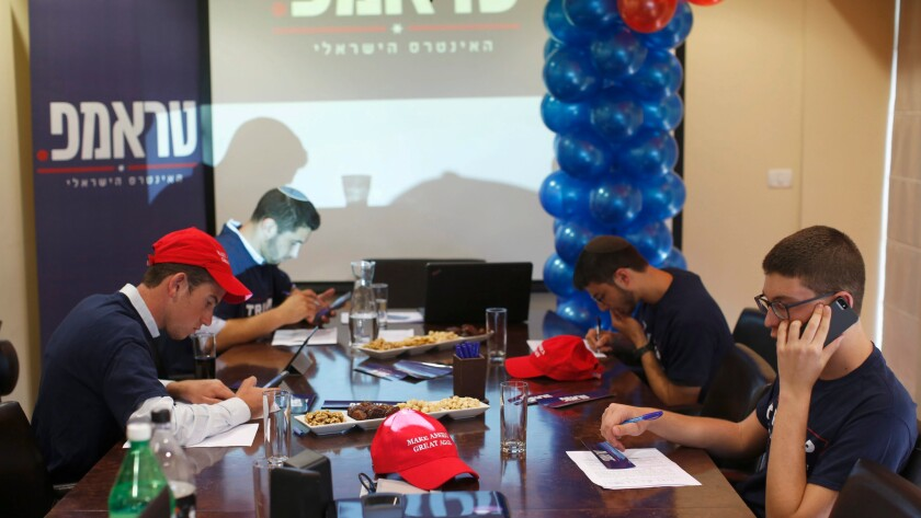 Activists with the group Republicans Overseas in Tel Aviv make calls to urge American expatriates in Israel to vote for Donald Trump.