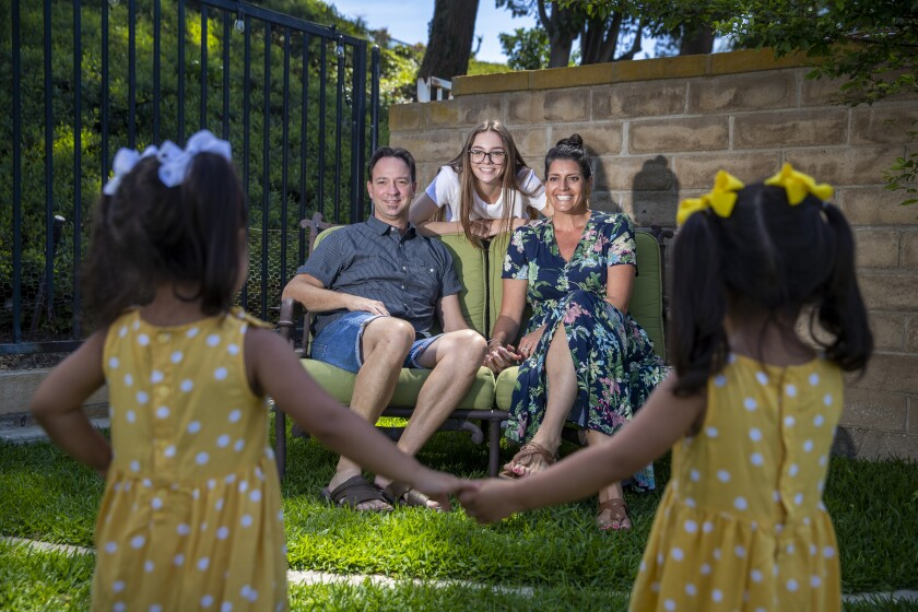 Natalia and Randall Bergman, with daughter Jessica, have been the foster parents of twin girls since they were 3 months old.