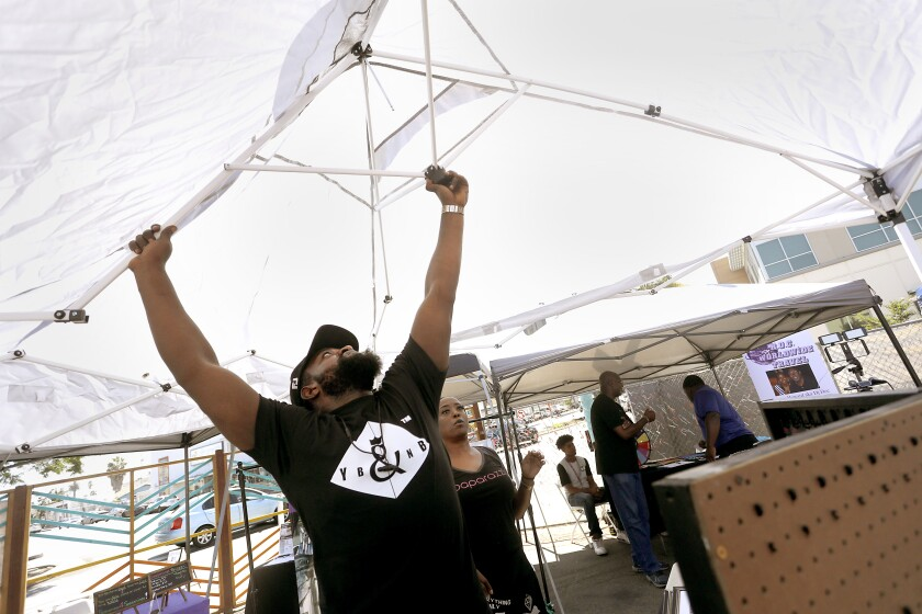 Abdoul Ngenda put up a tent at Fair@44 for the Summer Y.E.S. fest in 2019. After year-long closure, Fair@44 reopens Saturday.