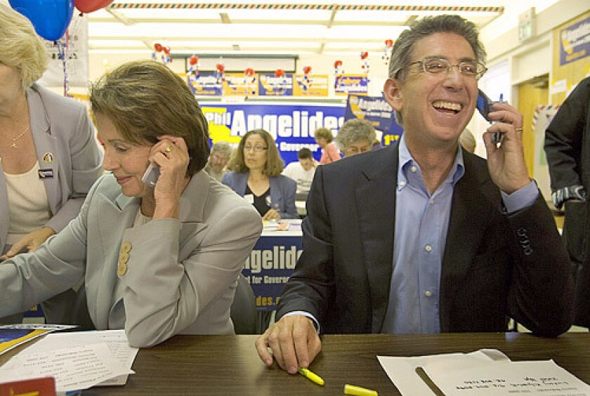 Rep. Nancy Pelosi and state Treasurer Phil Angelides, both Democrats, work a phone bank in Sacramento. Pelosi is likely to become speaker of the House if Democrats win control of the House on Nov. 7. Angelides is trailing in his bid for governor.