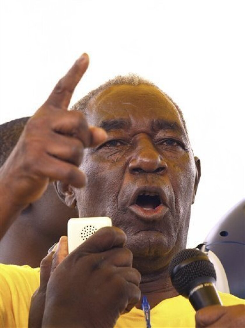 FILE - In this March 2008 file photo Edgar Tekere is seen addressing a rally in Highfileds, Harare. Edgar Tekere, a staunch friend and ally of Zimbabwe's president who then became one of the leader's harshest critics, has died at the age of 74. A statement Wednesday June 8, 2011 from representatives of his family says Tekere died Tuesday from cancer. (AP Photo/Tsvangirayi Mukwazhi-File)