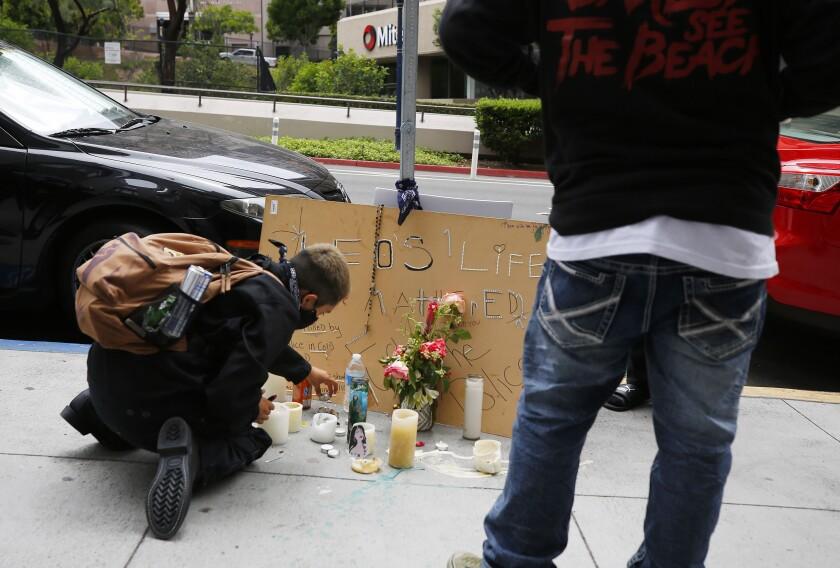 Candles were arranged where Leonardo Ibarra, 25, was shot by San Diego police on Sixth Avenue near A Street on June 27.