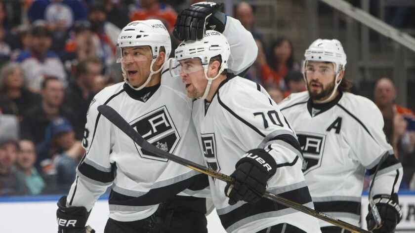 Los Angeles Kings' Jarome Iginla (88), from left, Tanner Pearson (70) and Drew Doughty (8) celebrate