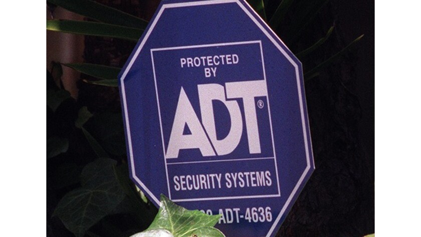 Alphabet Inc.'s Google has agreed to pay $450 million for a stake in security firm ADT Inc.