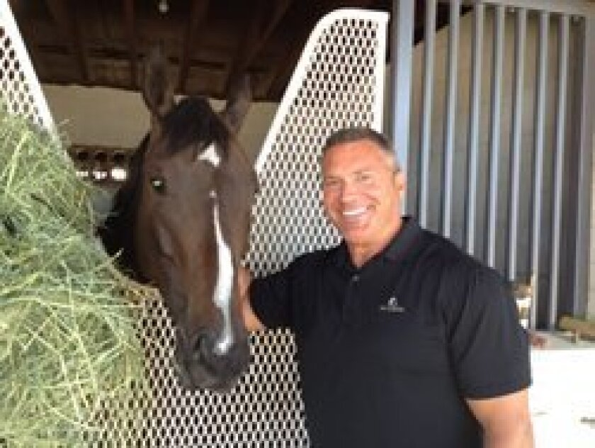 Jeff DeHaven with his mare Latin Lashes at Rancho Paseana in Rancho Santa Fe.  Courtesy photo
