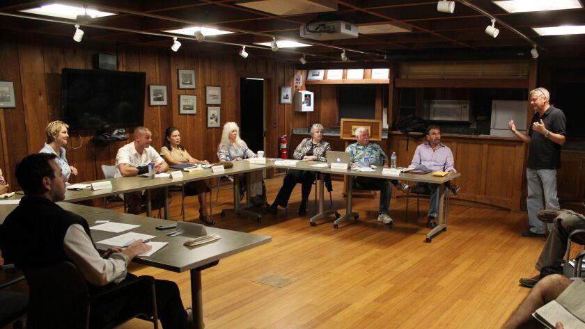 City engineer Steve Lindsay (right) explains construction project details at the Shores Association meeting, Nov. 9.