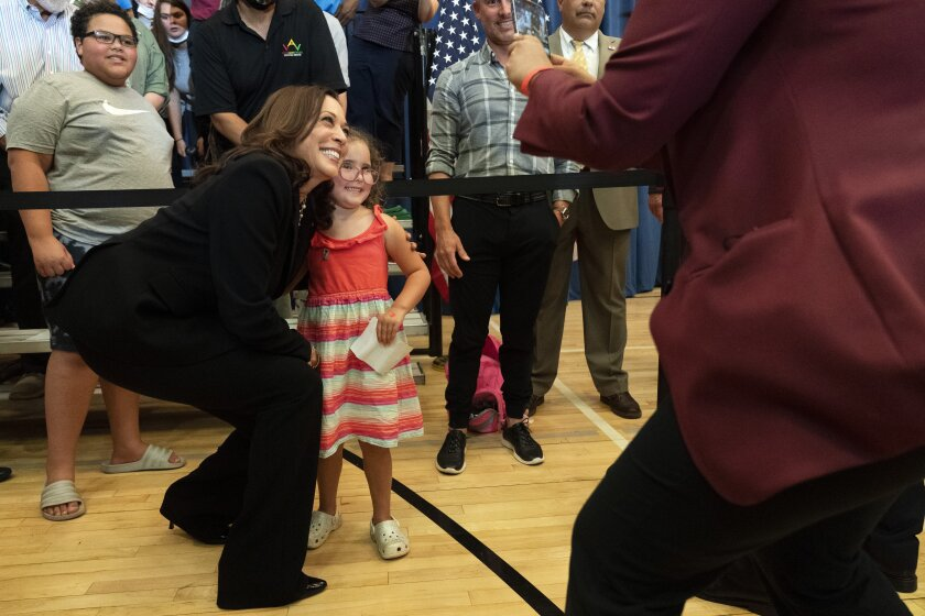 Vice President Kamala Harris leans in for a photograph with Stella Quatrini, after Harris spoke about the child tax credit at Brookline Memorial Recreation Center, Monday June 21, 2021, in Pittsburgh. (AP Photo/Jacquelyn Martin)