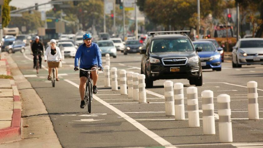 Cyclists navigate the westbound lanes of a new and controversial bike lane along Venice Boulevard in Mar Vista on March 5.