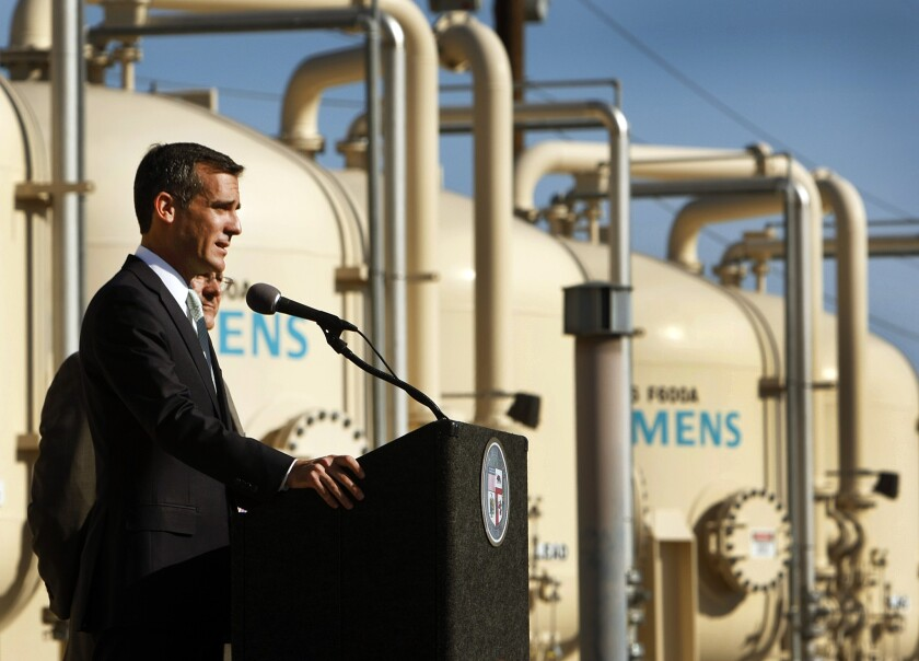 Mayor Eric Garcetti tours the Tujunga Spreading Grounds, a stormwater capture and groundwater replenishment project in Arleta, in 2014.