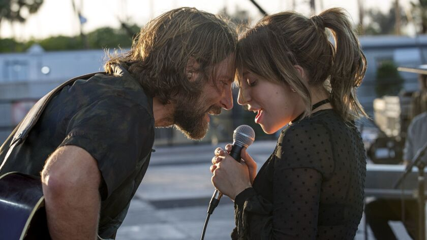 "(L-R) - Bradley Cooper and Lady Gaga in a scene from the movie ""A Star is Born."" Credit: Neal Presto"