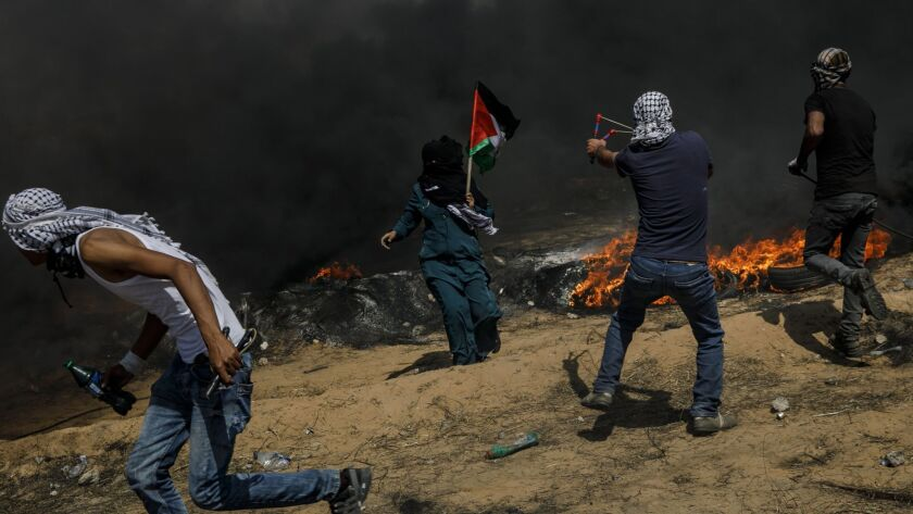 KHAN YOUNIS, GAZA STRIP -- FRIDAY, MAY 11, 2018: Under the shroud of smoke from the flaming tires,