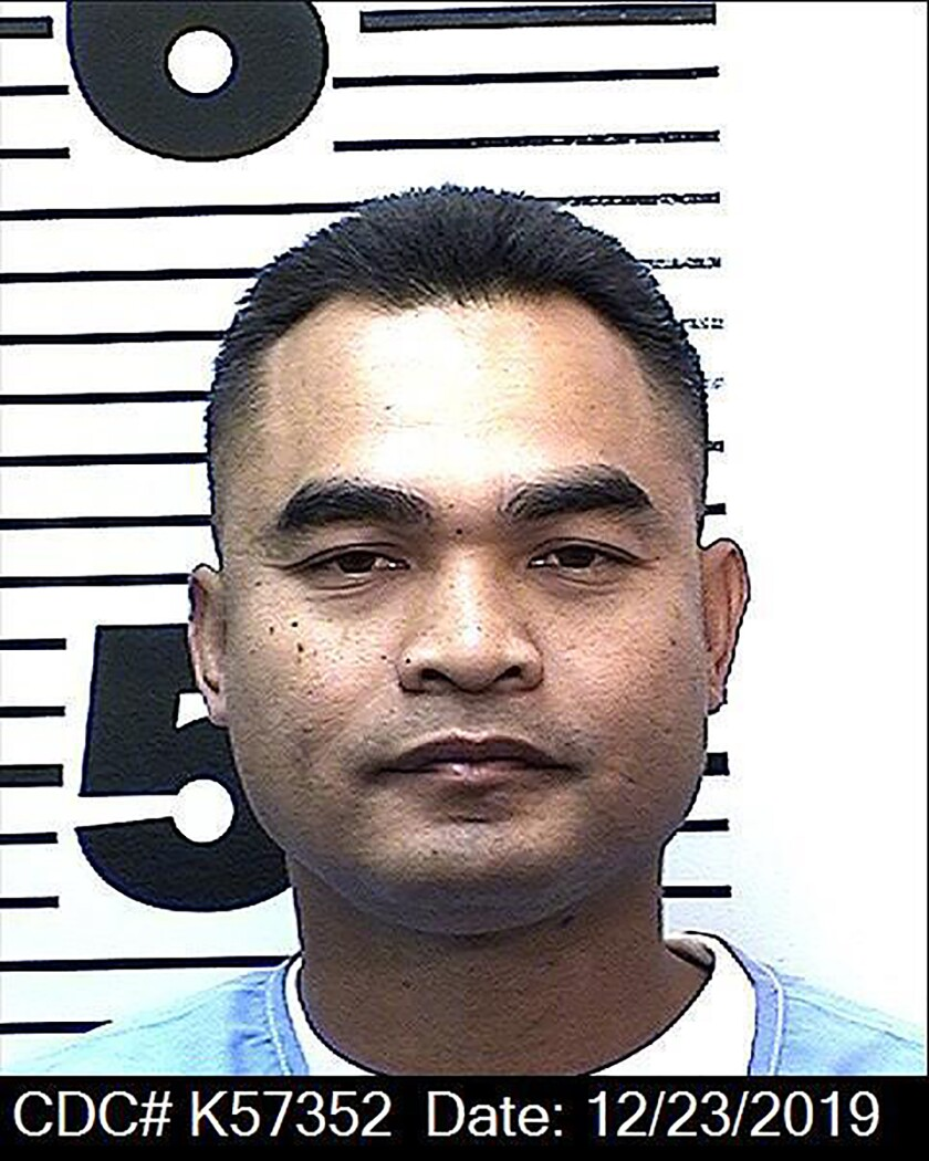 Tith Ton, who spent 22 years in prison, was released Monday on parole and immediately turned over to federal agents for possible deportation, according to his attorney.