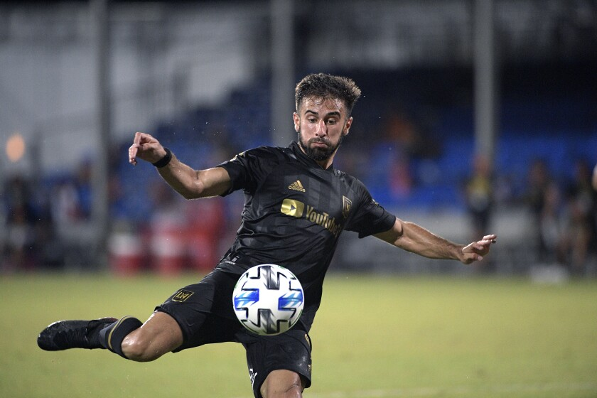 Los Angeles FC forward Diego Rossi (9) attempts a shot during the second half of an MLS soccer match.
