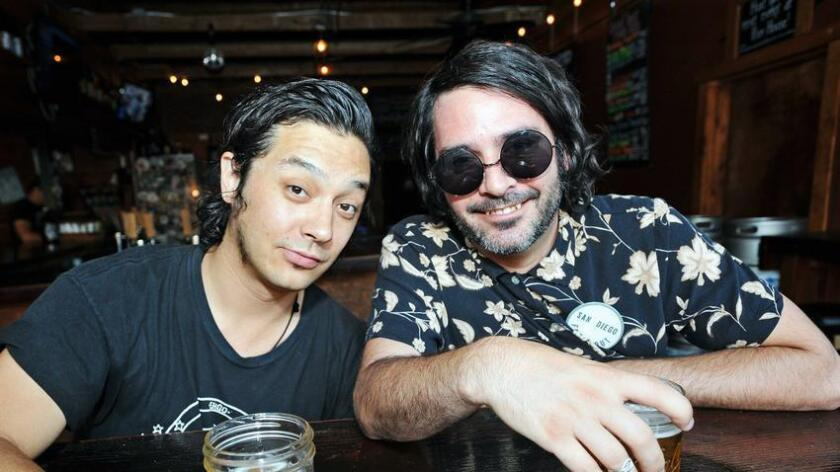 Members of Wild Wild Wets, Taejon Romanik (left) and Mike Turi enjoy their beers at Poor House Brewing Company in North Park. (Rick Nocon)