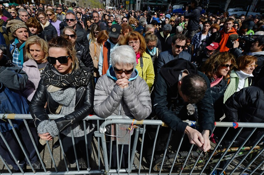People observe a moment of silence near the Boston Marathon finish line on the one-week anniversary of the bombings.