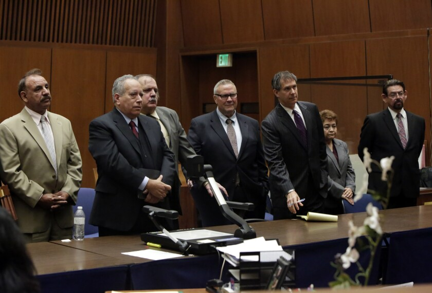 The five convicted former Bell council members, from left to right: Oscar Hernandez, Victor Bello, George Cole, Teresa Jacobo and George Mirabal.