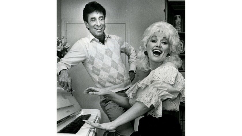 Dolly Parton and Sandy Gallin in 1983.