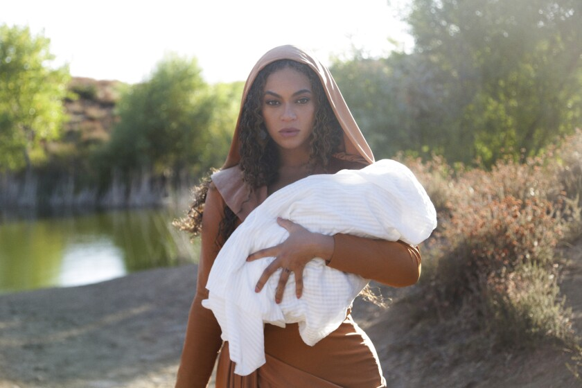 """This image released by Disney Plus shows Beyoncé in a scene from her visual album """"Black is King,"""" premiering Friday on Disney Plus. (Robin Harper/Parkwood Entertainment/Disney + via AP)"""