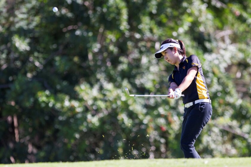 Torrey Pines' Jung Min Park pitches onto the 10th green. The Falcons won the team title for the seventh straight season.