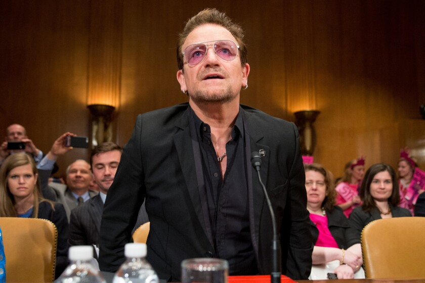 Singer Bono of U2 prepares to testify before a Senate subcommittee about extremists and foreign assistance.