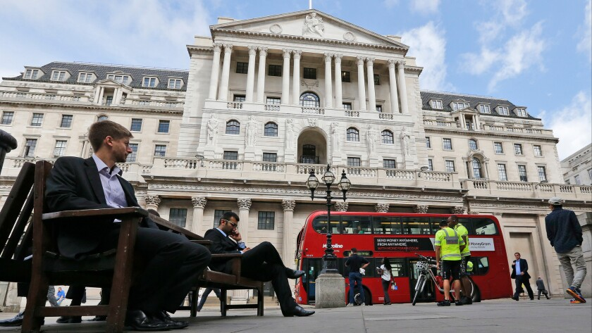 A London bus passes the Bank of England in London.