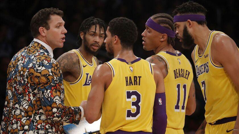 LOS ANGELES, CALIF. - NOV. 29, 2018. Lakers coach Luke Walton tlks with his team in the fourth qua