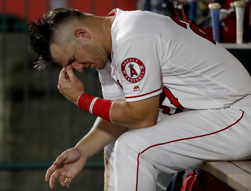Angels star Mike Trout reacts in the dugout during a loss Aug. 13, 2019.
