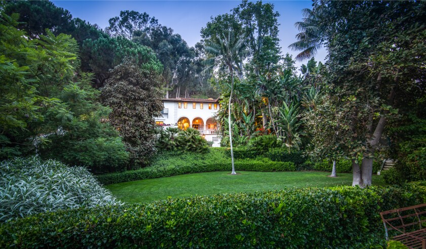 The 1930s mansion is part of a leafy spread.