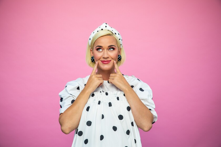 "Katy Perry is about to give birth to her first child and her fifth album, ""Smile."""