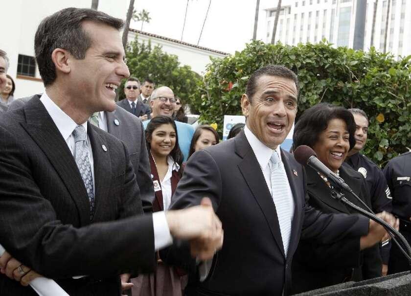 Eric Garcetti and L.A. Mayor Antonio Villaraigosa at an event at Union Station in 2011.